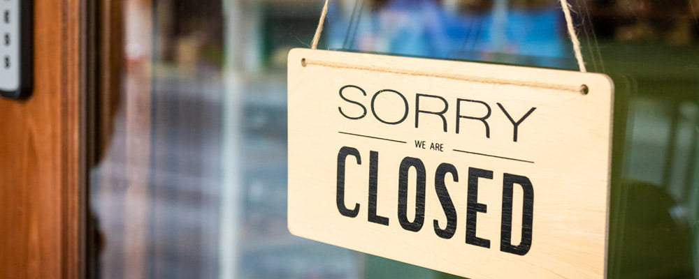 closed real estate sign